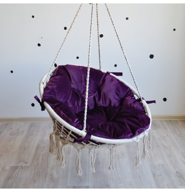 Hammock on a circle in the technique of macrame Infancy ™, with a purple cushion