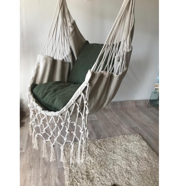 Hammock fabric hanging from the Infancy of velor 'Malachite' seaming netting on the sides
